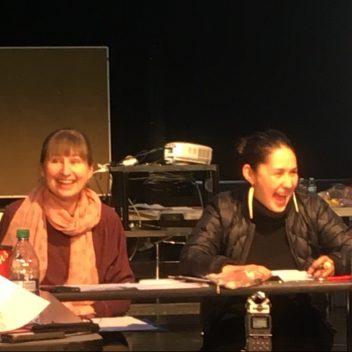 Buddy Wesley, Patti Flather, and Reneltta Arluk sitting around a U-shaped table.