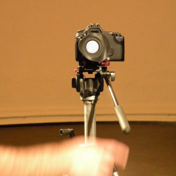 A camera facing forward on a tripod