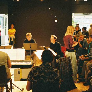 Group of people in a rehearsal room