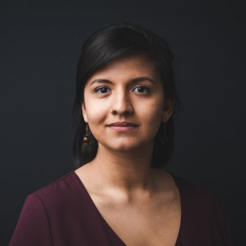 Headshot of Shanti Gonzales, with a dark background